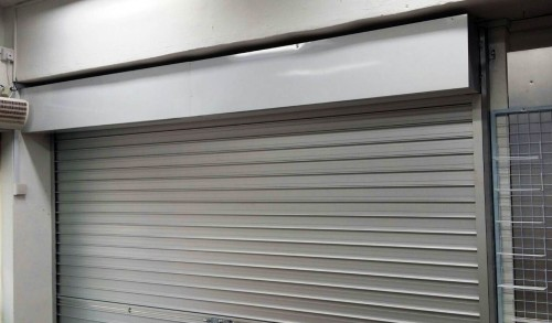 Glass Panel Replaced by Manual Aluminium Roller Shutters