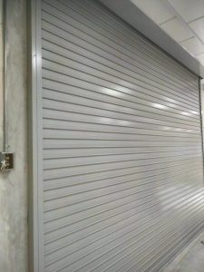 Grey Powder Coated Motorised Aluminium Roller Shutters Installation at Woodlands Link Completed