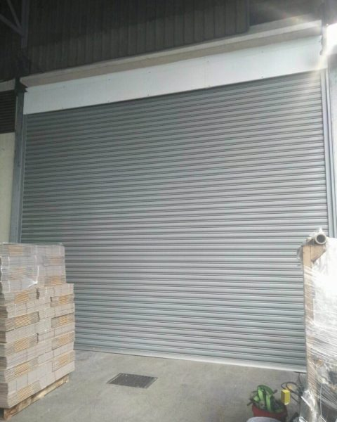 Replaced Old Steel Sliding Door with Motorised Steel Roller Shutters for Senoko Loop Warehouse