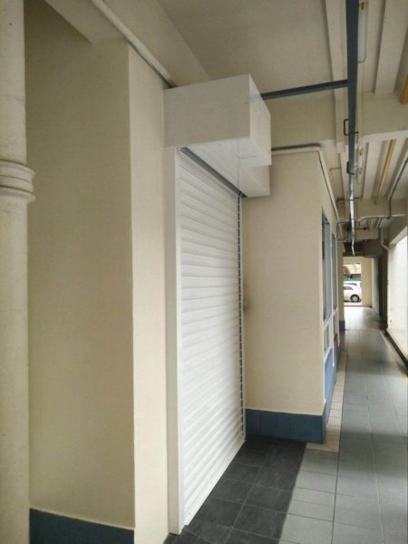 White Motorised Aluminium Roller Shutters Installed for Lengkong Tiga Childcare Centre