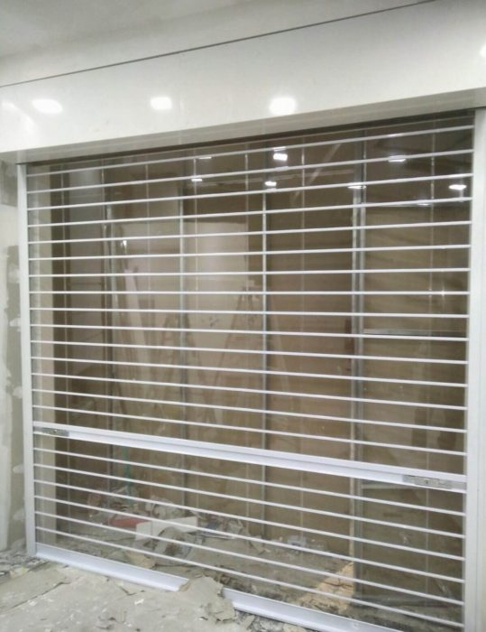 Manual Polycarbonate Roller Shutters Installed for Newly Renovated Shopping Mall Retail Shop in Sengkang
