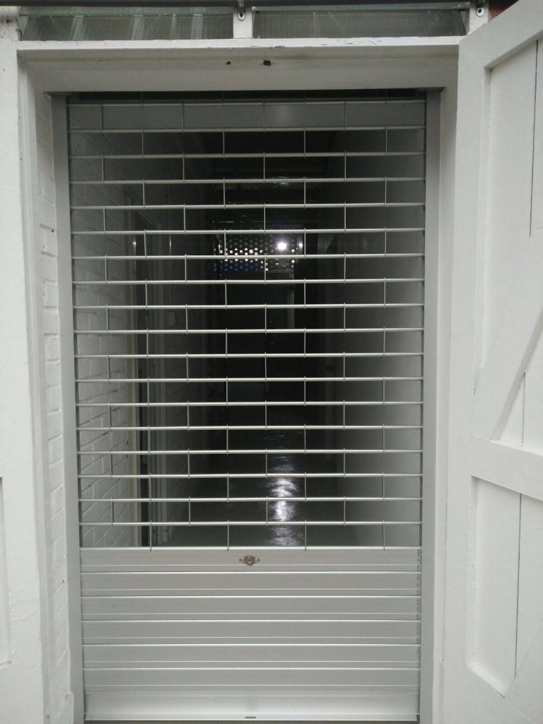 Aluminium Roller Grille with Flats Slats at the Bottom Area Installed for Factory