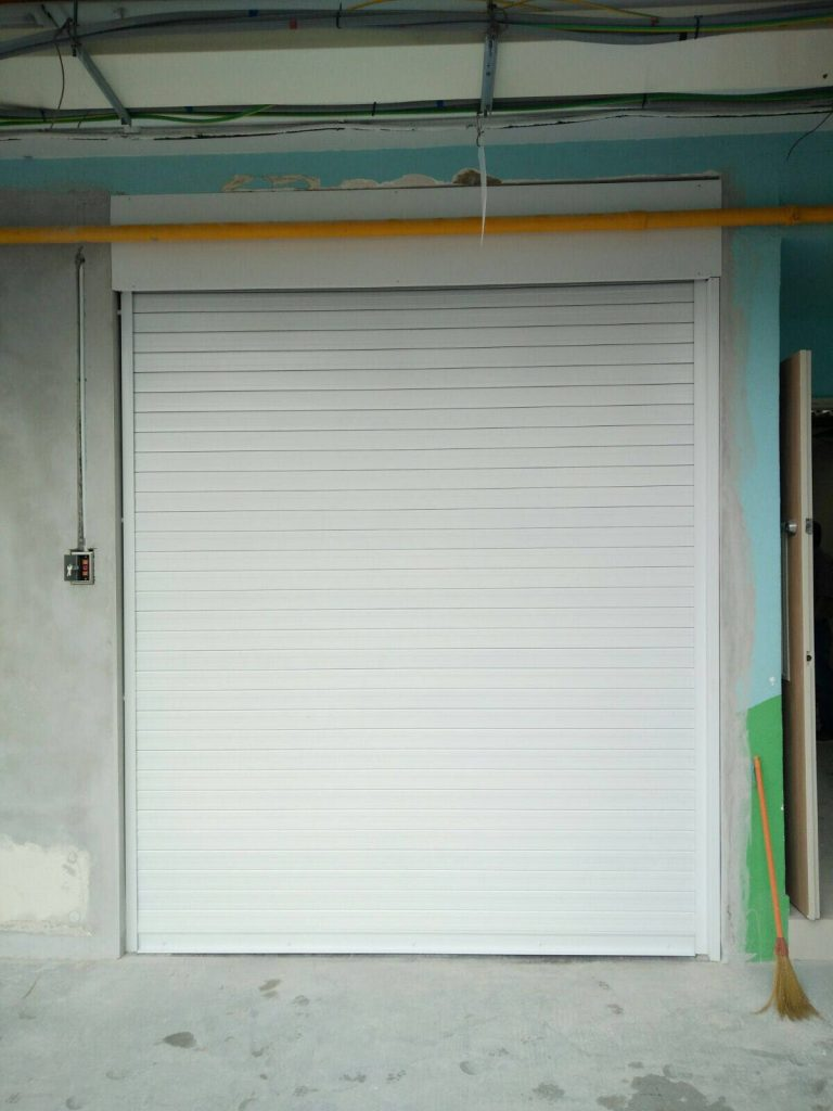 Motorised Operated Aluminium Roller Shutters in White Powder Coated Finishing for Front Entrance of Pre-School at Ang Mo Kio