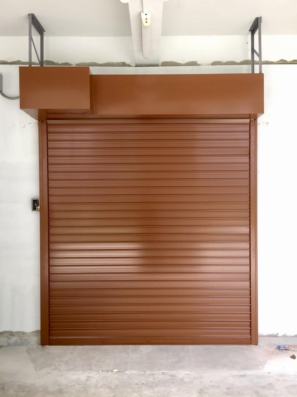 Motorised Operated Aluminium Roller Shutter in Powder Coated Finishing (Clay brown) for Preschool at Marsiling Road (Phase 2)