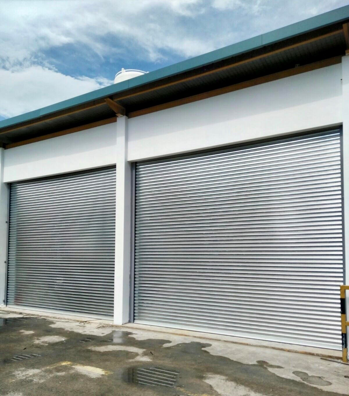 Two Sets of Motorised Operated Steel (Galvanised) Roller Shutter for New Extension of Stand-Alone Shed at Pioneer Sector