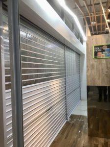 Manually Operated Top Multi-Vision Panel and Bottom Aluminium (Powder Coated Finishing) Roller Shutter for Supermarket at Yishun