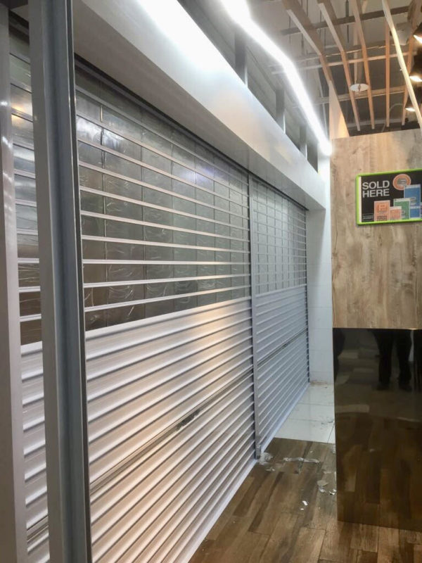 Manually Operated Top Multi-Vision Panel and Bottom Aluminium (Powder Coated Finishing) Roller Shutter for Supermarket at Yishun