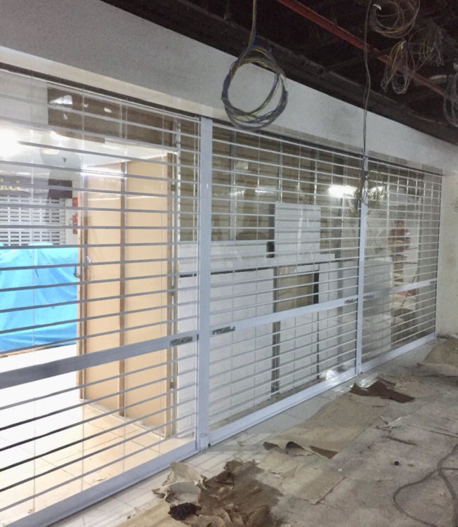 Manually Operated Multi-Vision Panel Roller Shutters for Cafe Entrance at Far East Plaza