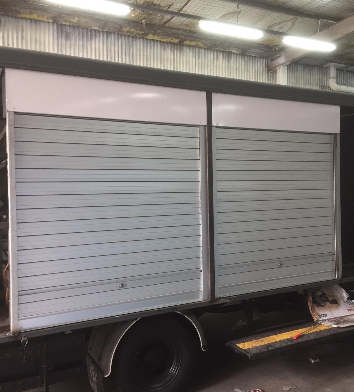 New Manually Operated Aluminium Roller Shutters Installed for Sides of Truck