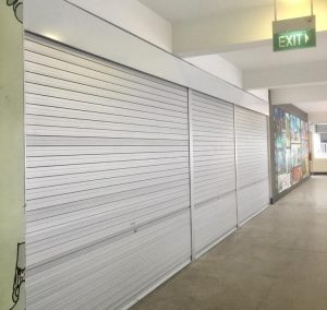 3 Panels of Manually Operated Aluminium Roller Shutters Installed at Multi Purpose Hall Entrance for Primary School
